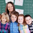 Happy teacher and students — Stock Photo