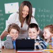 Stock Photo: Children and teacher