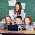 Teacher with laptop — Stock Photo