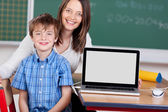 Schoolchild and teacher — Stock Photo