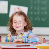 Happy young girl in the elementary school — Stock Photo