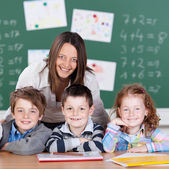 Pupils with teacher — Stock Photo