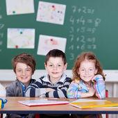 Three children in classroom — Fotografia Stock