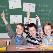 Three schoolchildren — Stock Photo