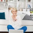 Woman looking at laptop and having fun — Stock Photo #27069307