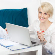 Young woman working at home — Stock Photo #27069333