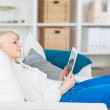 Young Woman With Tablet Sitting On Sofa — Stock Photo