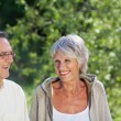 Elderly couple enjoying the greenery — Stock Photo