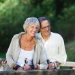 Senior Couple Looking Away While Hiking — Stock Photo #27074415