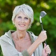 Old lady holding the golf stick — Stock Photo