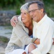 Senior Couple Looking Away While Embracing In Park — Stock Photo