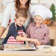 Happy Family Baking Cookies Together — Stock Photo