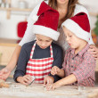 Stock Photo: Two little boys preparing cookies for christmas