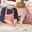 Brothers Using Cutters On Dough To Make Christmas Cookie — Stock Photo