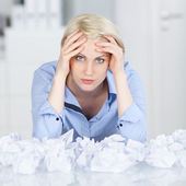 Tired executive With Crumpled Paper Balls At Desk — Stock Photo