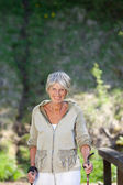 Happy Senior Woman Hiking In Forest — Stock Photo