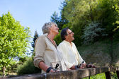 Retired but active couple enjoying the greenery — Stock Photo