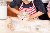 Boy Kneading dough for cookies — Stock Photo