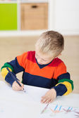 Boy Drawing On Paper At Table — Stock Photo