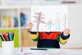 Boy Displaying Drawing At Table — Stock Photo