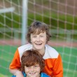 Friends having fun on soccer field — Stock Photo #27099115