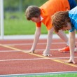 Young Runners On Starting Position At Racetrack — Stock Photo