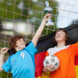 Two young soccer players celebrating with trophy — Foto Stock