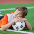 Teenager dreaming on soccer field — Stock Photo