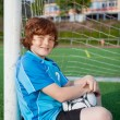 Young soccer player having a break — Stock Photo