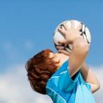 Happy winner kissing soccer ball — Stock Photo #27099927