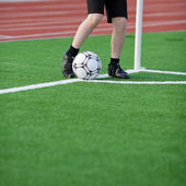 Boy Kicking Soccer Ball At Corner — Stock Photo