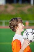 Young boy practising soccer — Stock Photo