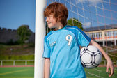 Young boy waiting at goal — Stock Photo