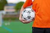 Young boy holding soccer ball — Stock Photo