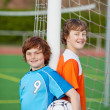 Boys Leaning On Net Pole At Soccer Field — Stock Photo