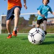 Boys Playing Football On Field — Stock Photo