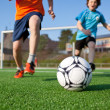 Stock Photo: Boys Playing Football On Field