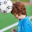 Soccer Player Headering The Ball — Stock Photo