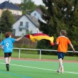 Boys Celebrating While Running With German Flag On Field — Stock Photo