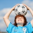 Boy Holding Soccer Ball On Head Against Sky — Stock Photo #27100805
