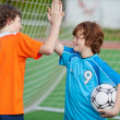 Stock Photo: Football Players Giving High Five