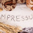 Impressum, written in flour — Stock Photo