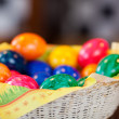 Basket of colourful Easter Eggs — Stock Photo