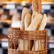 Crusty fresh baked bread in bakery — Stock Photo #27103411