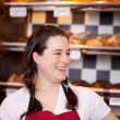 Stock Photo: Female apprentice at bakery
