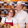 Friendly bakery staff — Stock Photo