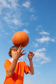 Basketball Player Spinning Ball Against Sky — Stock Photo