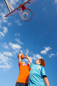 Boys Playing Basketball Against Sky — Stock Photo