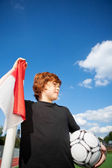 Boy Holding Soccer Ball While Standing By Corner Flag — Stock Photo