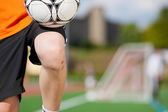 Boy Training With Soccer Ball At Field — Stock Photo